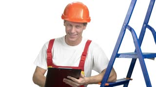 Cheerful supervisor writing on clipboard. Mature foreman looking at contruction and writing on clipboard, isolated on white background.