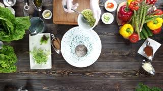 Chef making herring tartare. Food ingredients on brown table.