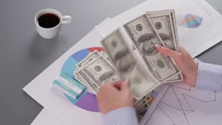 Chief Financial Officer counts profit. Business woman counts the money. Successful business project. Acceleration of shooting.