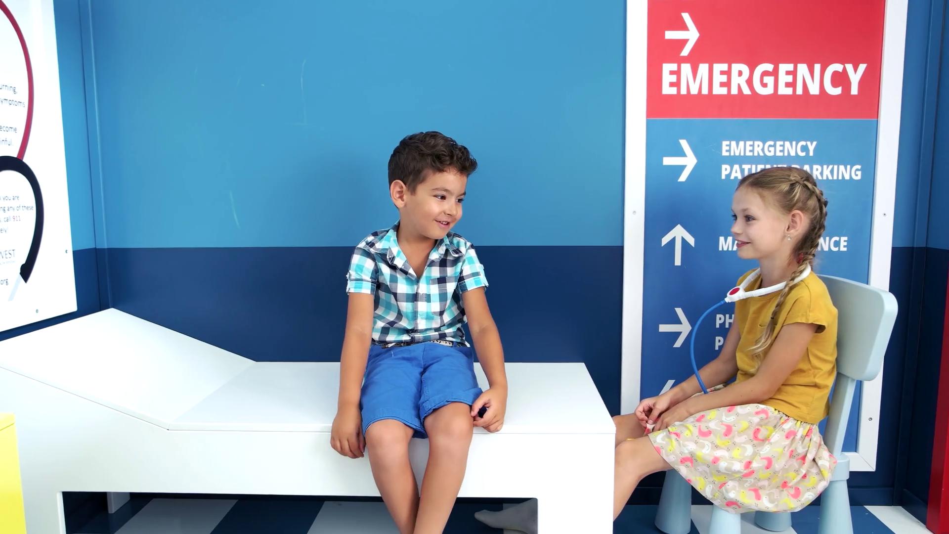 Children playing doctor in kindergarten. Kids in nursery school. Kids role game. Stock Video Footage - Storyblocks