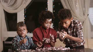 Children smeared in cake. Boys are eating dessert. Tell me the recipe. Three hungry brothers.