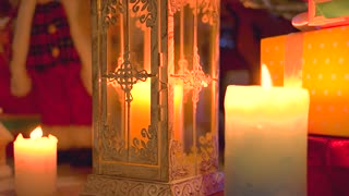 Christmas scene with burning candles. Lantern with burning candle. New Year festive composition.