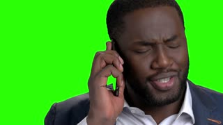 Close up afro american executive talking on phone. Dark-skinned boss talking on mobile phone on Alpha Channel background.