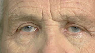 Close up eye of an elderly man. Wrinkled face of an old man close up. An older view.