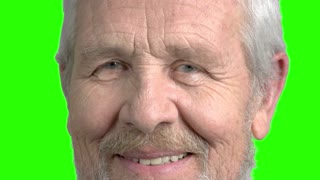 Close up face of old man, green screen. Caucasian senior man smiling face close up, chroma key background. Positive aged man.