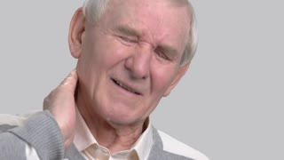 Close up man suffering from neck pain. Pinched nerve or nerve injury concept. How to heal from pinched nerve.