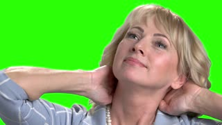Close up mature woman has relax. Pretty dreaming mature female on chroma key background. Woman is meditating.