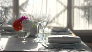 Close up of dining table. Empty glasses and sunlight.