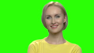 Close up portrait of beautiful smiling blond caucasian woman. Green hromakey background for keying.