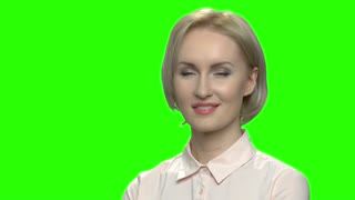 Close up portrait of smiling blond sexy woman. Green screen hromakey background for keying.