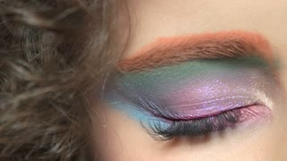 Colorful eye makeup and hair. Beautiful glitter eyeshadow.