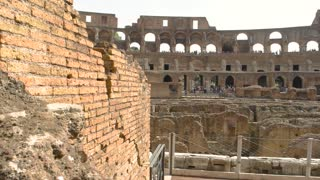 Colosseum and people. Historic landmark of Rome.