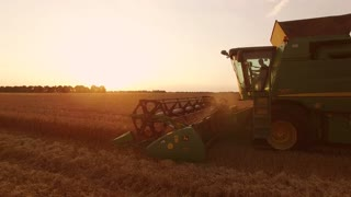 Combine, field and sky. Improved farming methods.