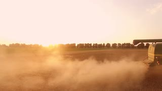 Combine harvester and dust. Agriculture and technology.