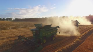 Combine harvesters and dust. Rapid growth of agribusiness.