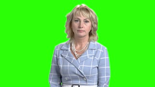Confident business woman on green screen. Suprised mature woman in elegant wear on chroma key background.