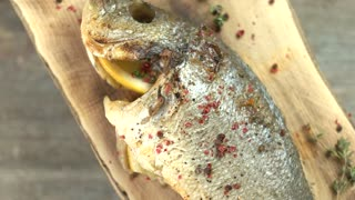 Cooked fish with spices. Dorado top view.