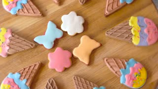 Cookies with colorful icing. Desserts shaped as ice cream. Pastry for home party.