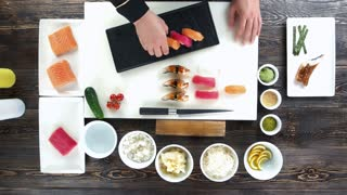 Cooking table, sushi. Hands of chef, japanese dish.