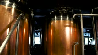 Copper brew kettles. Red copper beer brewing tanks, brewery equipment. Brewery machines made of copper.