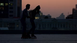 Couple is rollerblading outdoors. Two people in evening city. Roll with me. Moments worth remembering.