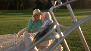 Couple on meadow. Senior man and woman laughing. Best days of our life. When love stops time.