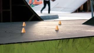 Crossed legs of inline skater. Rollerblader in motion.
