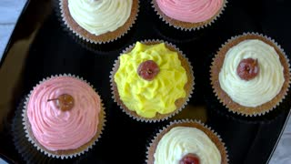 Cupcakes with cream cheese frosting. Small colorful desserts. Easy recipe of tasty pastry. Soft flavor and beautiful design.