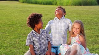 Cute children are playing on the sunny glade with a smile and have fun.