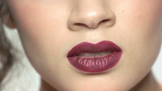 Dark red lips. Mouth of young woman, makeup.