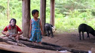Dark-skinned children in rural areas. Children outside his home. Mountain children.