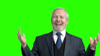 Desperate elderly businessman, green background. Senior man in formal wear gesturing with hands in desperation, chroma key background. Expression of trouble and frustration.