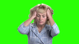 Desperate mature woman on chroma key background. Depressed anxious businesswoman pulling her hair on Alpha Channel background. Human expression of despair.