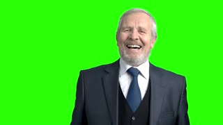 Desperate senior businessman, green background. Slow motion frustrated elderly man in grey business suit on chroma key background. Risk in business.