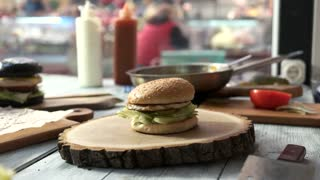 Different burgers on the table. Hamburgers and wooden boards. New fast food joint.