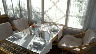 Dining table and chairs. Tableware and flowers. New restaurant opening.