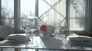 Dining table and sunlight. Plates, napkins and forks. Best restaurant reviews.