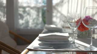 Dining table close up. Empty wineglasses and sunlight. New restaurant ideas.