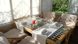 Dining table near window. Empty plates and glasses. Cheap restaurant design ideas.