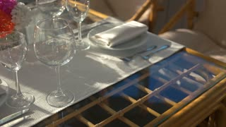 Dinner table and sunlight. Empty shiny glasses.