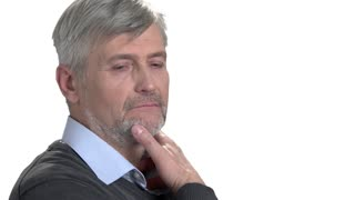 Download handsome business man thinking while touching his chin. Portrait of serious rich milddle-aged man. White isolated background.