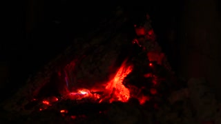 Dying fire. Coals home fireplace.