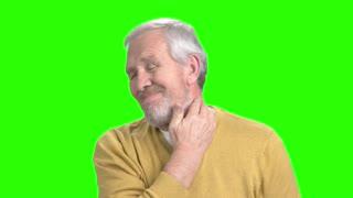 Elderly man suffering from neckache. Unhappy senior man having terrible neckache, alpha channel backgrouund.