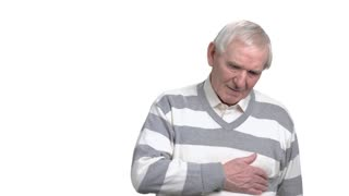 Elderly old man with discomfort in chest. Older man having chest pain, isolated on white background. Heart disease concept.