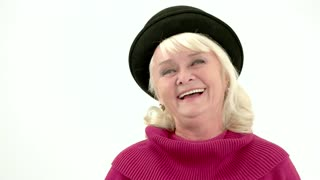 Elderly woman laughing in slow-mo. Happy lady on white background. Laughter helps you live longer.