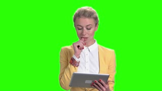 Elegant business woman working on digital tablet. Pretty confident business lady using portable tablet on chroma key background.