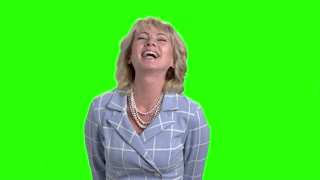 Elegant woman is laughing on green screen. Slow motion female corporate bursting into laugh on Alpha Channel background.