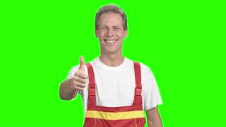 Engineer man showing thumb up sign. Smiling happy worker giving two thumbs up hand gesture standing on alpha channel background.