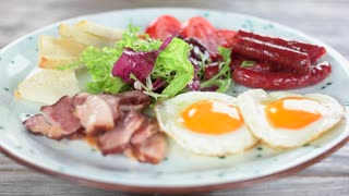 English breakfast close up. Fried eggs, bacon and vegetables.