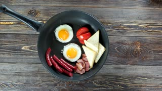 English breakfast in frying pan. Food on the table.